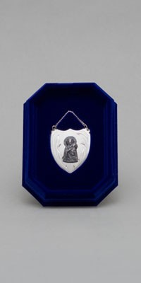 Medalla votiva de plata